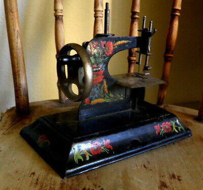 Old tin CASIGE sewing machine toy