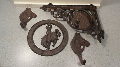 Cast Iron 2 Horse Head shelf bracks and 2 coat hangers and 1 plaque western
