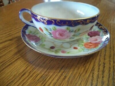 awesome old tea cup and plate