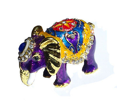 Elephant   Metal gold-colored with enamel rhinestones hidden compartment    ME12