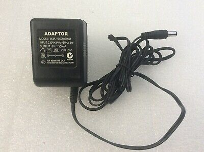 Ac Adapter Model : WJA-Y35060300D ,6V 300mA.