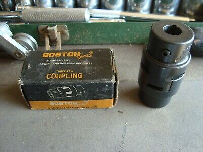 """Boston gear FC-15  1/2"""" - 5/8"""" coupling halves with spider insert."""