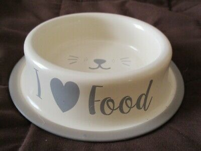 I love food, smiley face cat food dish, used once