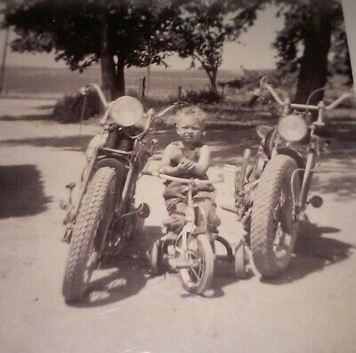 Vintage 1950s photo snapshot child on tricycle between   2 Indian motorcycles ?