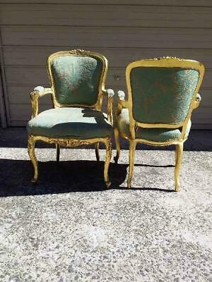 Pair Of Gilt Ornate French Baroque Louis Fauteuil Style Carved Armchairs. C 1930