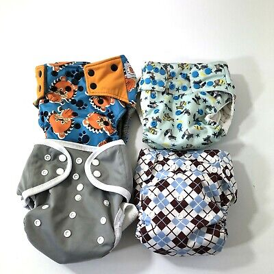 Lot of 4 cloth diapers inserts happy flute raccoon lion argyle sweet pea