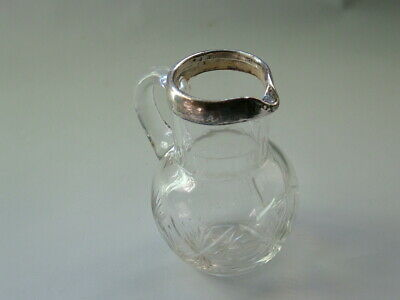 Silver & glass cream jug.