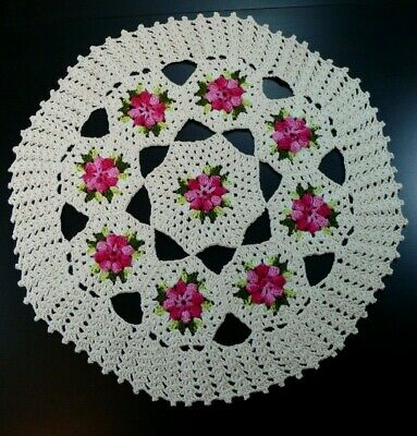 Handmade crochet ivory and pink round tablecloth.