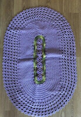 Hand crochet lilac and green bedside rug with flowers.