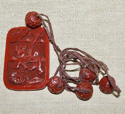 A Chinese Cinabbar Lacquer Necklace.