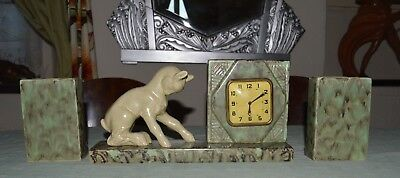 Art deco ceramic glazed French clock with Garnitures