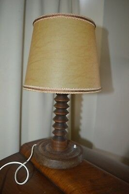 Arts & crafts wooden stand lamp with pig skin shade.