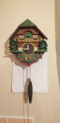 One weight Antique Wood  xmas style Cuckoo Clock in good working order
