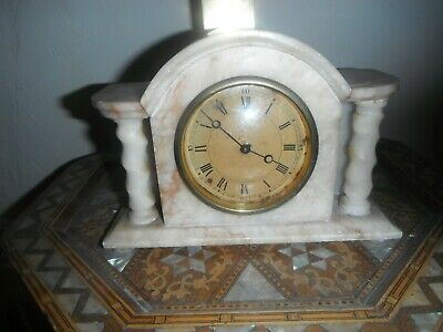 Antique marble clock in shape of temple creamy colour swiss made pretty