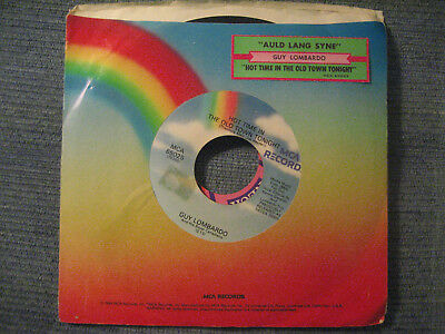 Re 45 - GUY LOMBARDO Auld lang Syne/Hot Time In The Old Town  w/ sleeve/strip EX