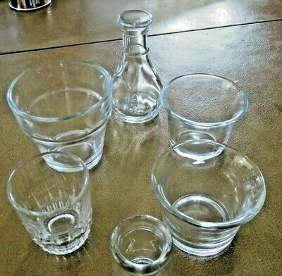 Variety of small clear glass containers, 6 pieces.