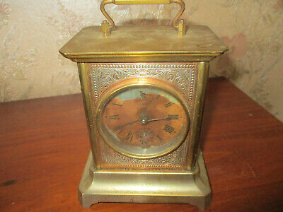 "Genuine antique brass and glass ""Louis style"" cased carriage clock"