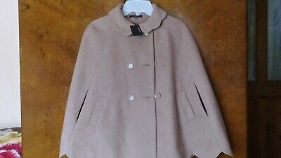 Next girls sleveless coat, size 9-10 years old, new with a tag