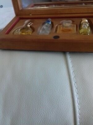real french miniture perfumes in wooden box with mirror at the back