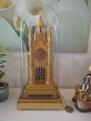 Gilt Cathedral Antique Clock With Glass Dome