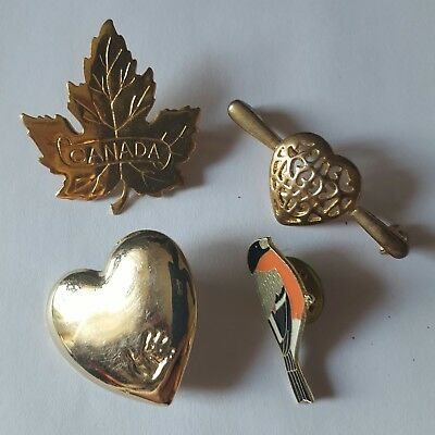 A lovely job lot of 4 gold tone vintage and modern brooches