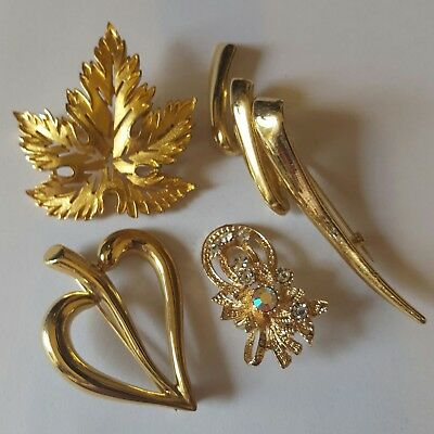 A lovely job lot of 4 vintage and modern gold tone brooches inc Avon