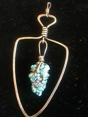 Native American Handmade silver Arrowhead With Large Natural Turquois stone.