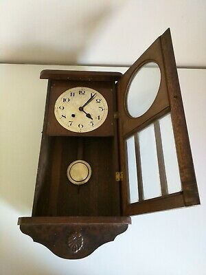 A Well Aged Original Wooden Pendulum Wall Clock In Need Of Full Restoration.