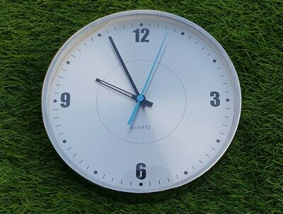 Vintage retro 1980s style stainless steel effect Quartz wall clock