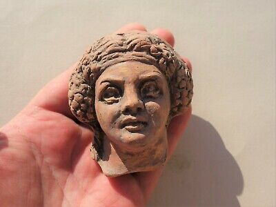 ancient Roman pottery fragment of hollow head of god Dionysus, 1 - 2 century AD.