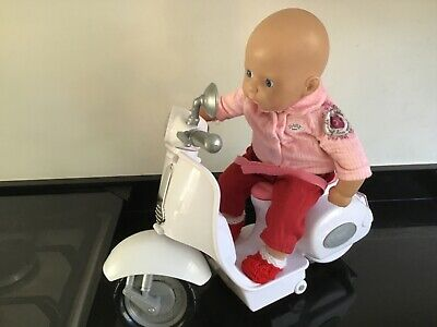 Zapf Creation Dressed Doll on Interactive Baby Born Scooter.