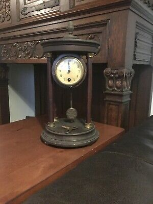 Antique H.A.C. Pillar Clock . Key wind H.A.C.Mantel Clock with round Brass Movem