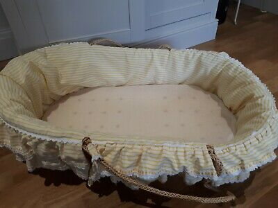 Moses basket with hand made covers. Comes with base mattress from Mothercare