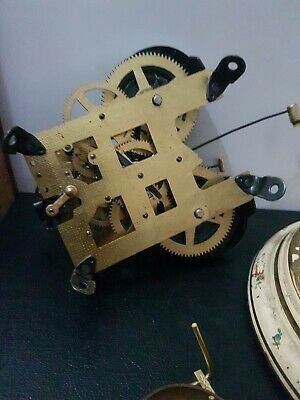 Brass double strike clock movement  spares or repair and large glass dome