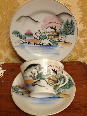 Antique cup, plate and saucer.