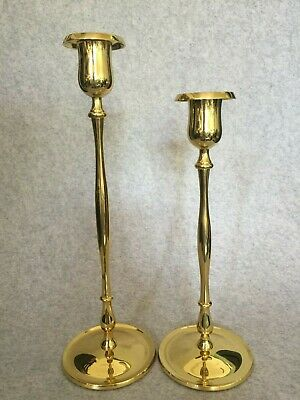 a pair of Hutchinson slim solid brass candlesticks medium and tall new in box