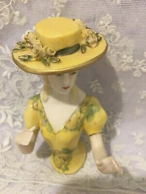 """PorcelainHalf Doll """"Juliette with hat"""" approx 10 cms tall painted in yellow"""