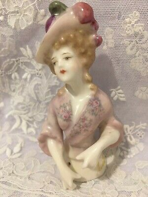 """Porcelain Half Doll """"Carlotta"""" approx 10 .cms tall painted in pink with decals"""