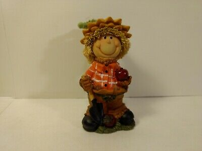Greenbrier Scarecrow Kid With Shovel & Apples Polystone Fall Decoration h152