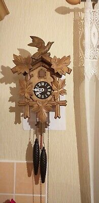 A large Antique Wooden Cuckoo Clock  in good working order