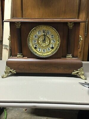 Antique Gilbert 8 day time and strike with bell on 1/2 hour as well mantle clock