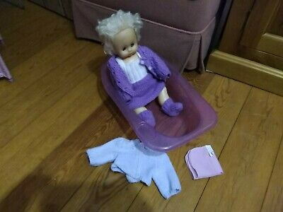 Doll bath tub - Used. Comes with pink flannel and hooded snuggle towel