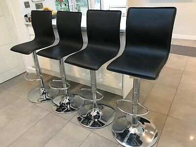 Four Black Leatherette & Chrome Base Swivel Gas Lift Bar Stools.
