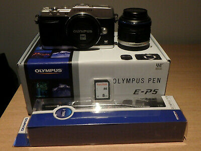 Olympus Pen E-P5 silver and 14-42 lens excellent condition only 995 Shots