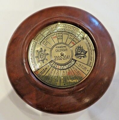 Hand turned red gum maritime calendar signed
