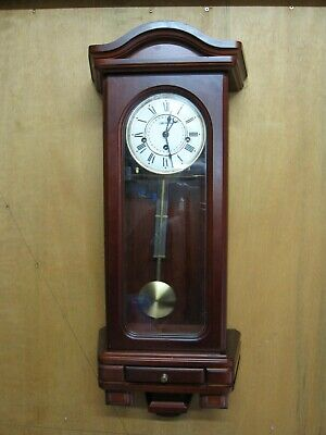 Pendulum wall clock with chimes, by William Widdop. Wood case.