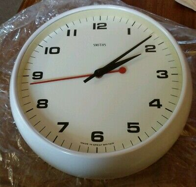 "A vintage retro ""Smiths"" 11"" industrial factory electric wall clock."