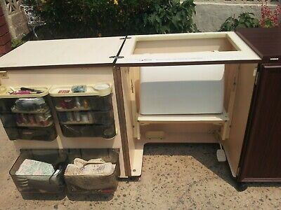 Horn sewing cabinet with Janome sewing machine and Elnalock overlocker