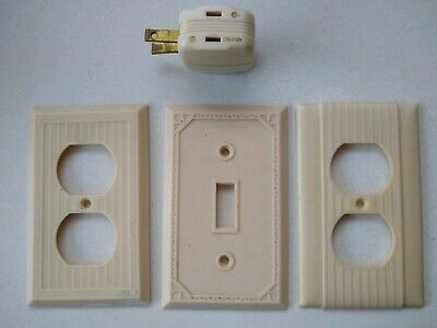 3 vintage bakelite decorative and ribbed ivory switch plates + plug