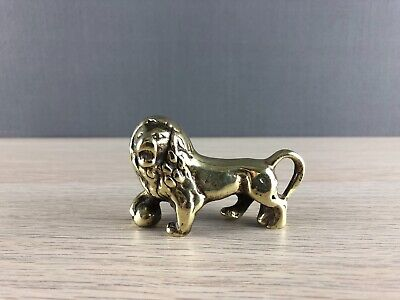 Vintage solid polished brass lion with paw on sphere / medici lion figurine gift